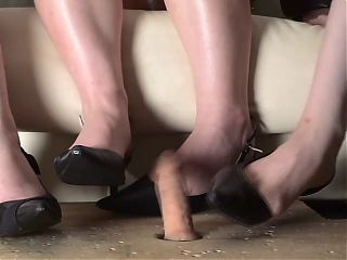 3 Japanese women in high heels play with dildo
