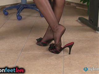Two redhead secretaries give a shoeplay show in nylons