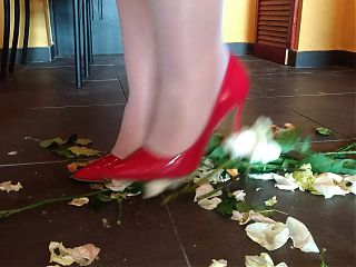 wife crush flowers in red dress and heels